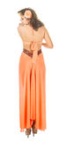 Fashion female back view. Fashion female dressed in orange back view Royalty Free Stock Images