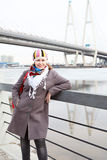 Fashion female on city embankment Stock Photo