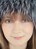 Fashion female in fur hat Stock Image