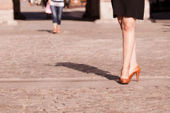 Fashion. Female legs in stylish shoes outdoor Stock Photography