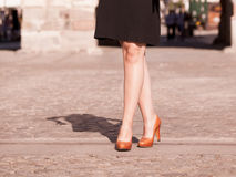 Fashion. Female legs in stylish shoes outdoor Royalty Free Stock Image