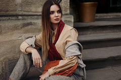 Fashion Female Model In Fashionable Clothes Posing In Street. Portrait Of Beautiful Sexy Woman In Stylish Fall Or Spring Clothing : Shirt, Scarf, Pants, Bag Stock Images