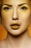 Fashion Female Model with Gold on Face Stock Images