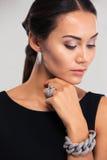 Fashion female model posing in black dress Stock Photos