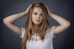 Fashion female model studio portrait. Female rmodel in white dress portrait on gray background royalty free stock images
