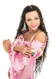 Fashion female in pink dress. Dark-haired fashion female in pink dress isolated on white Stock Image