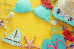 fashion female swimsuit bikini on yellow wooden background. Summer beach vacation concept Stock Photography