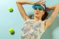 Fashion female with tennis balls stock photos