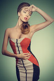 Fashion female with vogue dress Royalty Free Stock Image