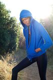 Fashion fitness model posing in blue sweatshirt outdoors Royalty Free Stock Image