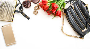 Fashion flat lay with accessories, flowers, phone Royalty Free Stock Photo