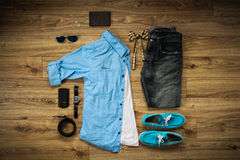 Fashion flat lay of modern casual clothes. Flat lay. Top view. Flat lay of clothes set such as blue shirt, blue shoes, orange checkered bowtie, watches, belt royalty free stock image