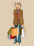 Fashion Fox carrying shopping bags Royalty Free Stock Images
