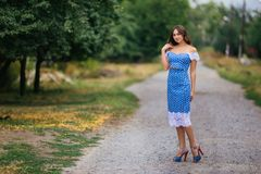 Fashion full-length portrait of young pretty trendy woman posin royalty free stock image
