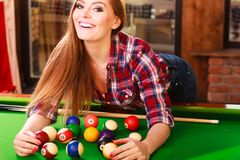 Young woman having fun with billiard. Fashion and fun concept. Young charming girl posing by billiard pool. Attractive fashionable woman casual style spending Stock Photos
