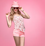 Fashion Funny girl Having Fun. Trendy pink Hat. Fashion woman Having Fun. Blond Model Girl in Stylish Spring Summer Outfit Smiling. Fashion Sunglasses, Glamour Royalty Free Stock Photos