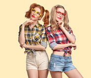 Fashion Funny girl Thinking Idea. Smiling Nerd. Fashion Hipster women Thinking Idea. Having Fun. Hipster Sisters Best Friends Smile. Twins in Trendy Plaid Shirt royalty free stock photo