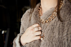 Fashion fur coat and jewellery Stock Photos