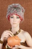 Fashion futuristic gold bronze woman piggybank stock images