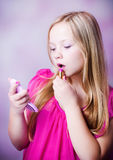 Fashion girl. Cute young girl doing make up Royalty Free Stock Photos