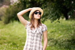 Fashion girl. Beauty young woman wearing fedora hat and sunglasses Royalty Free Stock Images