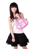 Fashion girl. A Chinese fashion girl holds a handbag on white background Royalty Free Stock Images