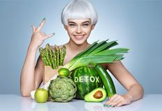 Fashion girl with an abundance of fruits and vegetables. stock photography