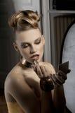 The fashion girl applying lipstick Royalty Free Stock Photos