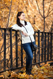 Fashion girl in autumn park Royalty Free Stock Photography