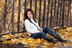 Fashion girl in autumn park Stock Photos