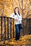 Fashion girl in autumn park Royalty Free Stock Photo