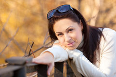 Fashion girl in autumn park Royalty Free Stock Image