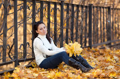 Fashion girl in autumn park Stock Photos