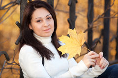 Fashion girl in autumn park Stock Images