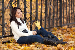 Fashion girl in autumn park Royalty Free Stock Photo