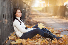 Fashion girl in autumn park Royalty Free Stock Images