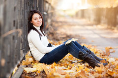 Fashion girl in autumn park Stock Image