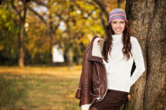 Fashion girl in an autumn setting Stock Photos