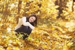Fashion girl in autumn wood Royalty Free Stock Images
