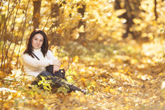 Fashion girl in autumn wood. Fashion pretty girl in autumn wood looking into the distance Stock Photo
