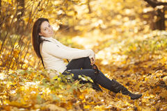 Fashion girl in autumn wood Stock Image