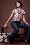 Fashion girl with bag, 2. Fashion portrait of beautiful young brunette girl Royalty Free Stock Images