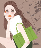 Fashion girl with bag Royalty Free Stock Image