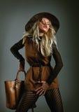 Fashion girl with bag Stock Image