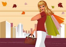Fashion girl with bags in city.  Stock Photo
