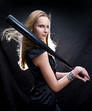 Fashion girl with the baseball bat. Fashion girl in black dress with the baseball bat stock image