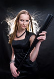 Fashion girl with the baseball bat. Fashion girl in black dress with the baseball bat stock photography