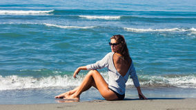 Fashion girl on beach Stock Images