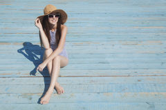 Fashion girl on the beach. Summer vacations Royalty Free Stock Photography