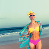 Fashion Girl on the Beach. Trend summer swimsuit and accessories Stock Photos